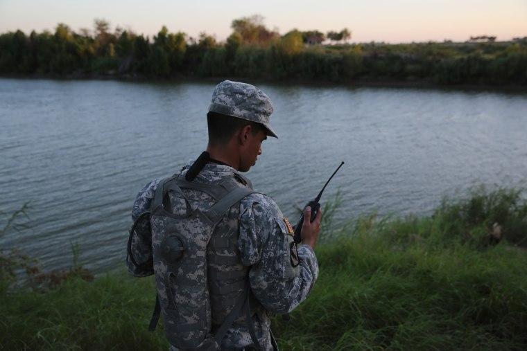 Image: A Texas National Guard soldier checks his radio while monitoring the U.S.-Mexico border