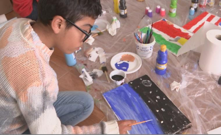 Image: Child from Nea Kalava refugee camp paints