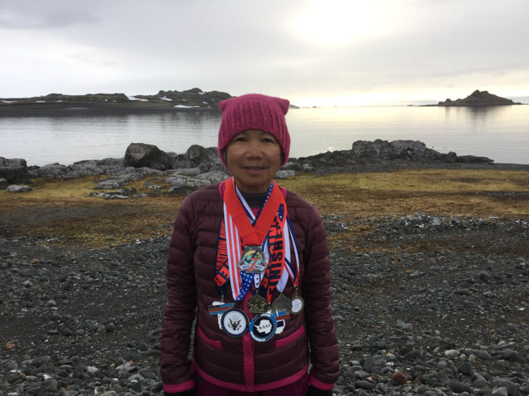 Chau Smith, 70, near the finish line in Antarctica with her seven marathon medals.