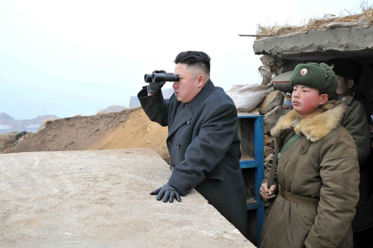 Image: Kim Jong Un uses binoculars to look at South Korean territory from an observation post on Jangjae islet