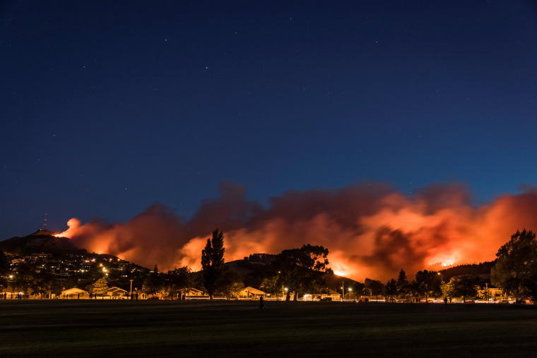 Image: Wildfires threaten a suburb of Christchurch on New Zealand's South Island taken after sunset