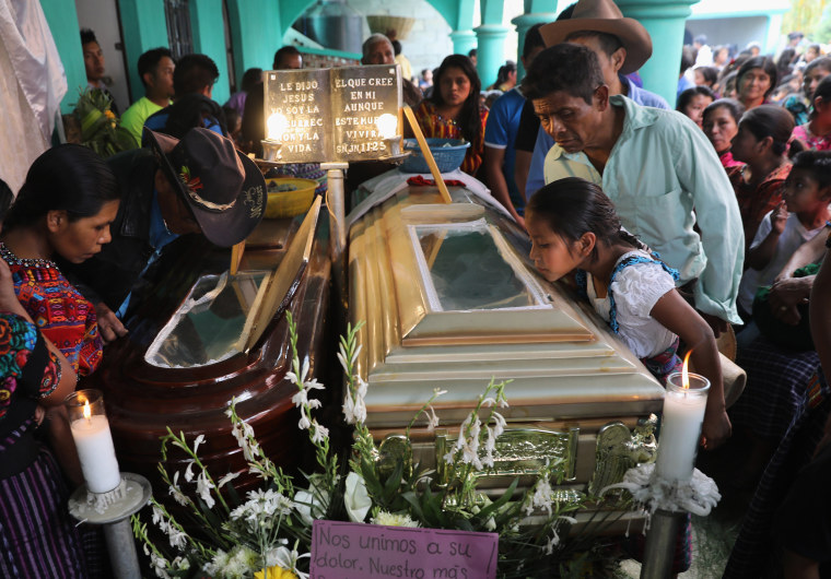 Image: Residents attend a wake for two boys who were kidnapped and killed in San Juan Sacatepequez