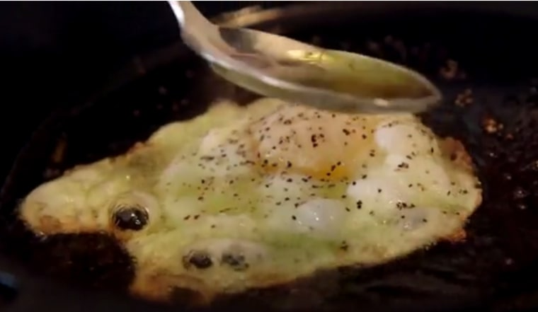 Spoon oil over egg for 30 seconds