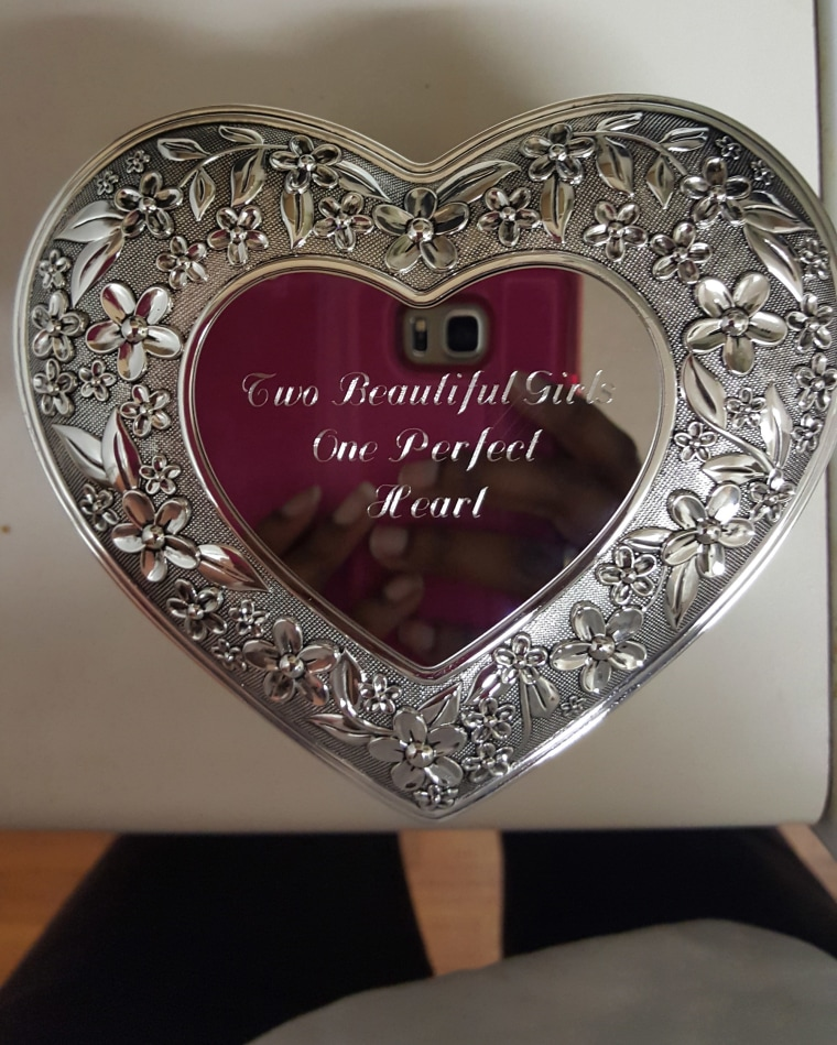 "Amber gave Ashlyn and Peyton this heart-shaped jewelry box. It reads: ""Two beautiful girls, One perfect heart."""