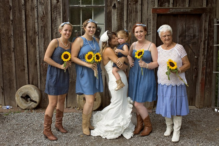 The bridesmaids all wore denim outfits and cowboy boots.