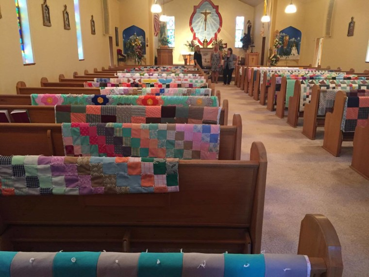 Margaret Hubl's quilts were draped over each pew at her church to honor her memory.