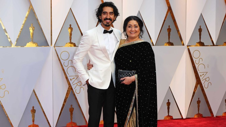 Dev Patel and his mother on the Oscars red carpet