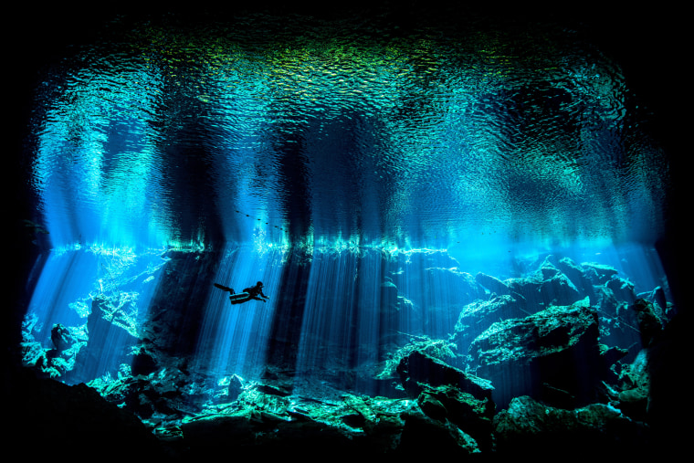 Image: Kukulkan Cenote on Mexico's Yucatan Peninsula forms part of the Chac Mool system and is noted for the spectacular light effects as the sun penetrates the darkness.