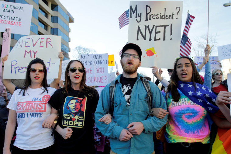 "Image: Anti-Trump protesters march towards the White House during the ""Not My President's Day"" rally in Washington, D.C., on Feb.20, 2017."