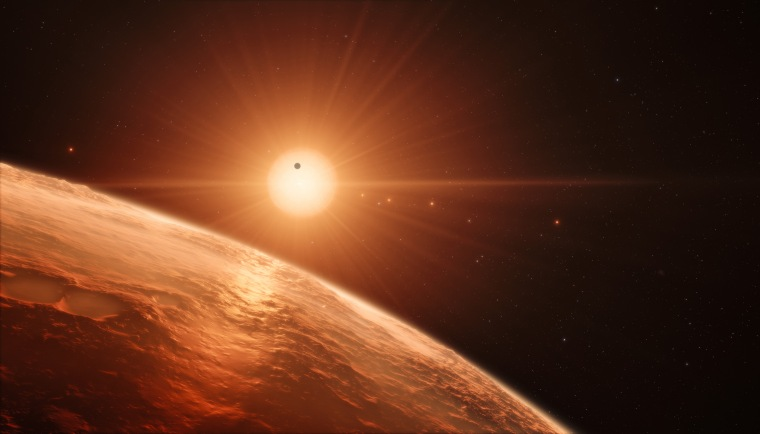 Image: This artist's impression shows the view from the surface of one of the planets in the TRAPPIST-1 system.