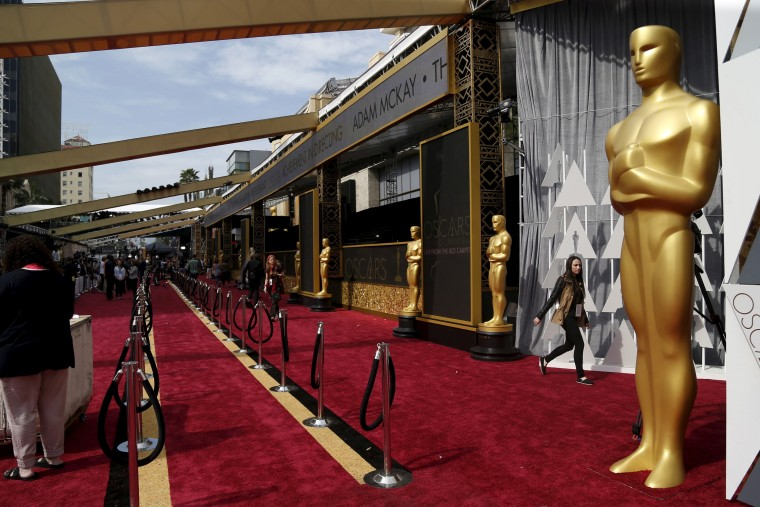 Image: File Photo: Oscar statues are pictured on the red carpet at the Dolby Theater during preparations leading up to the 88th Academy Awards in Hollywood