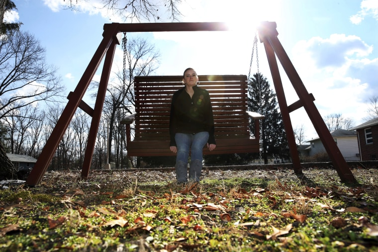 Image: In this Monday, Jan. 30, 2017, photo, Ashley Grant sits on a swing near her home in Bridgeton, New Jersey.