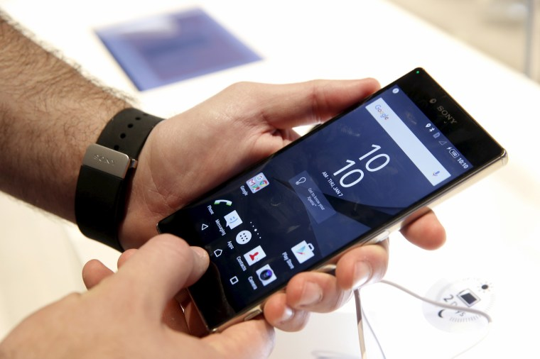 Image: An attendee looks over a Sony Z5 Premium smart phone in the Sony booth during the 2016 CES trade show in Las Vegas, Nevada, Jan. 7, 2016.
