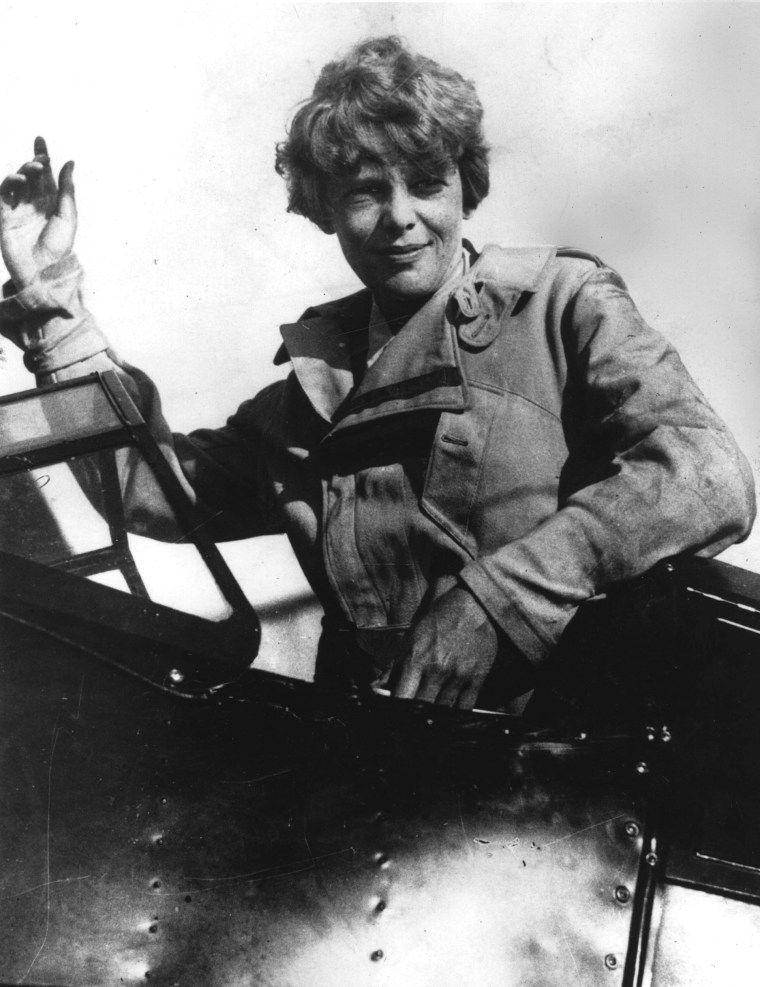 Image: Amelia Earhart waves from the cockpit of her plane circa 1929.