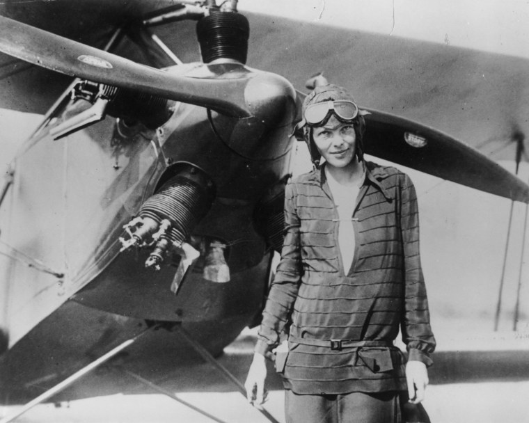 "Image: Amelia Earhart stands June 14, 1928 in front of her bi-plane called ""Friendship"" in Newfoundland."