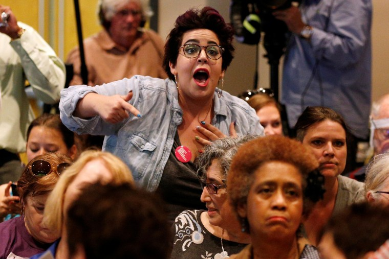 Image: A woman shouts during a town hall meeting for Republican U.S. Senator Bill Cassidy in Metairie