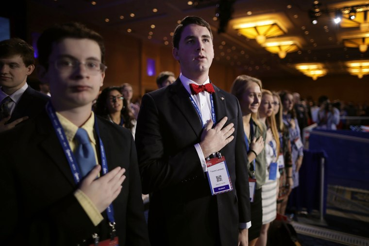 Image: CPAC attendees stand for the Pledge of Allegiance