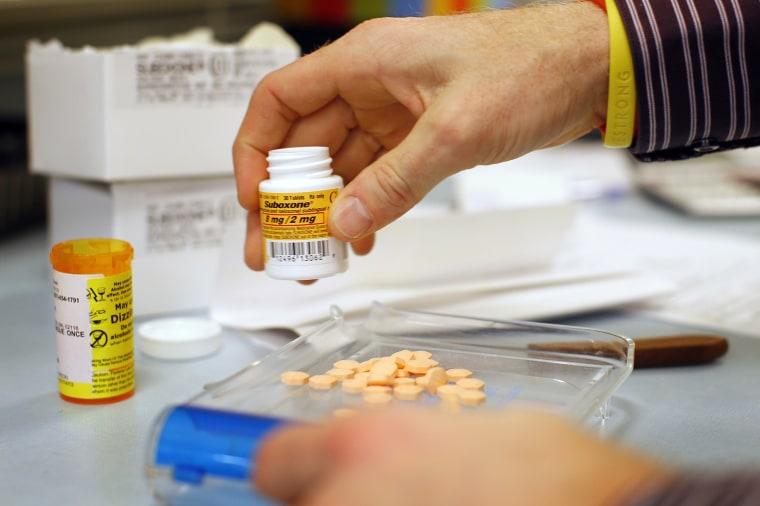 Image: A pharmacist fills a Suboxone prescription in Boston
