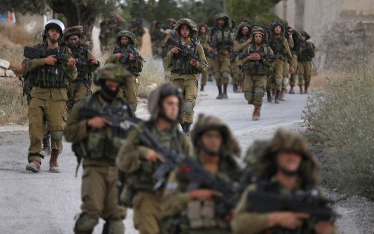 Image: Israeli soldiers patrol on the West Bank village of Arura