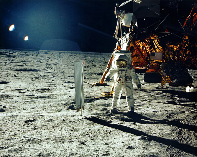 Image: United States astronaut Buzz Aldrin stands beside a solar wind experiment next to the Lunar Module spacecraft on the surface of the Moon