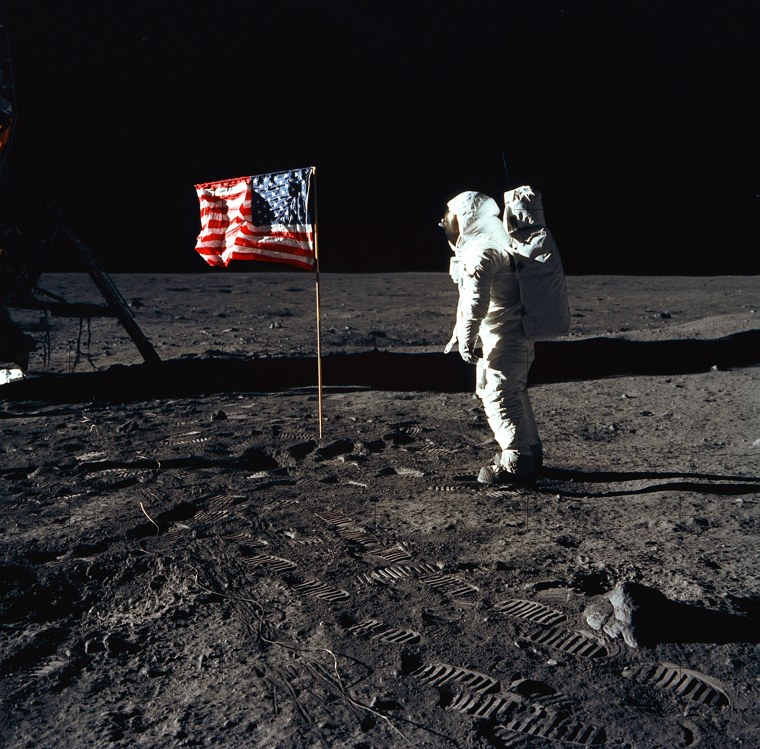 Image: Astronaut Edwin E. Aldrin Jr., lunar module pilot of the first lunar landing mission, poses for a photograph beside the deployed United States flag