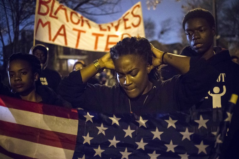 Image: Protesters, demanding the criminal indictment of a white police officer who shot dead an unarmed black teenager in August, march through a suburb in St. Louis, Missouri, Nov. 23, 2014.