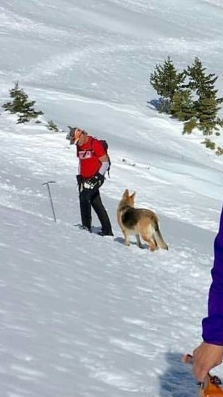 Warren Muldoon and Dakota the dog hike together in the snow.