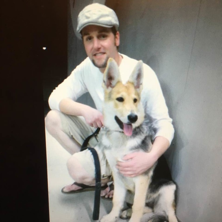 James Muldoon with Dakota the dog
