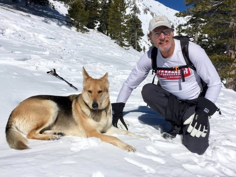 Warren Muldoon is pictured on a hike with Dakota the dog.