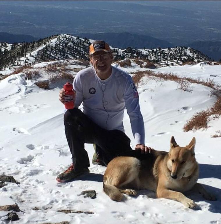 Warren Muldoon on a hike with Dakota the dog