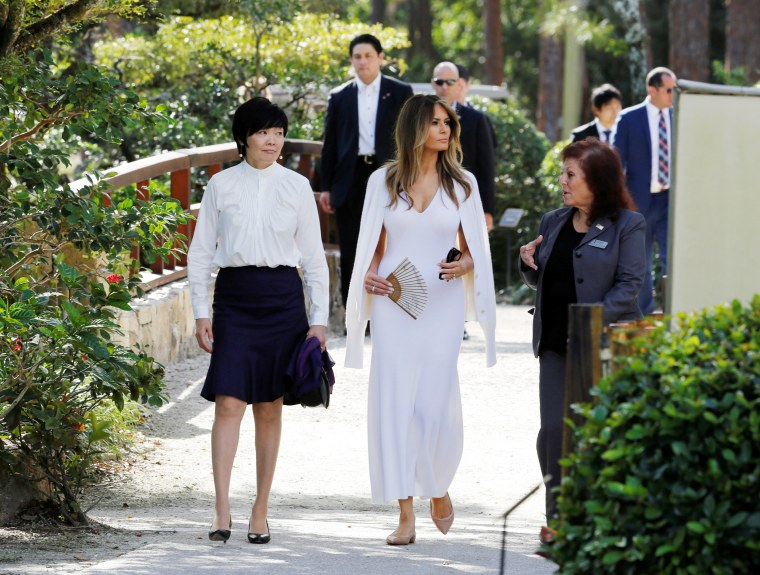 Image: U.S. First Lady Melania Trump and Akie Abe, wife of Japanese Prime Minister Shinzo Abe, listen to Park Administrator Bonnie White Lemay, as they tour Morikami Museum and Japanese Gardens in Delray Beach