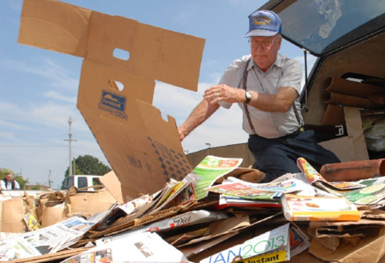 Mr. Johnny unloading a truck full of paper products that will make up his donation.