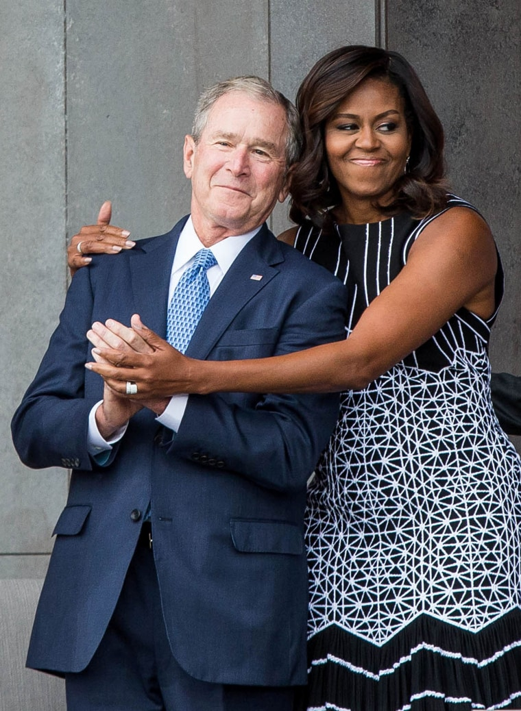 George W. Bush got a sweet hug from  Michelle Obama at the opening ceremony for the Smithsonian National Museum of African American History and Culture on Sept. 24 in Washington, D.C.