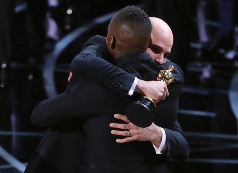 Image: Jordan Horowitz and Barry Jenkins hug