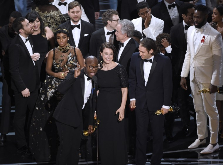 Image: Barry Jenkins and the cast accept the award for best picture