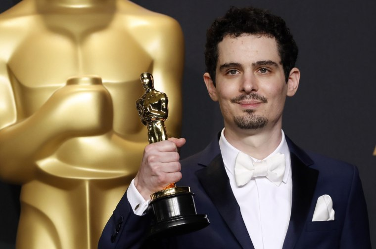 "Image: Damien Chazelle poses backstage with his Oscar for Best Director for the film ""La La Land"""