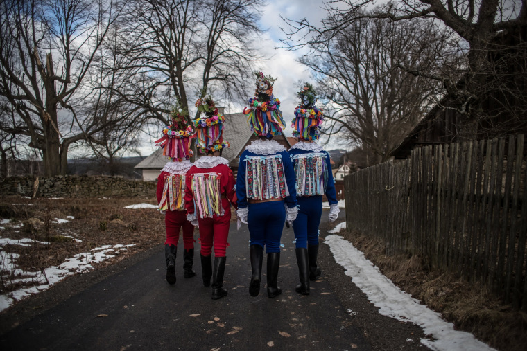 Image: Men dressed in a traditional carnival costume walk from house to house during the traditional folklore carnival parade in the village of Vortova, near Hlinsko, Czech Republic, Feb. 25, 2017.