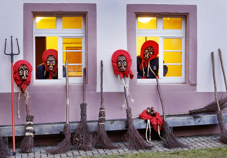 Image: Witches of the Waldkircher Kandelhexen Witches' Club look out of windows as they prepare to celebrate the traditional witches' sabbath at the market square of Waldkirch, southern Germany, Feb. 25, 2017.
