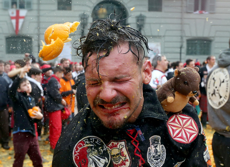 Image: A member of a rival team is hit by an orange during an annual carnival orange battle in the northern Italian town of Ivrea, Feb. 26, 2017.