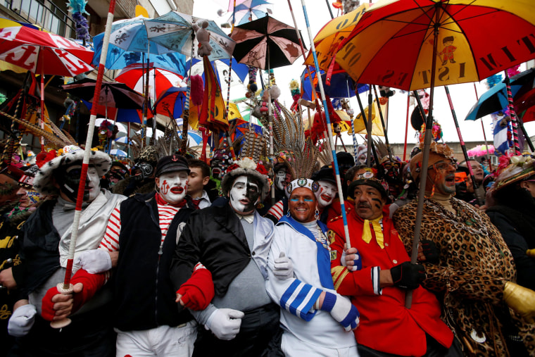 "Image: People wear local carnival costumes during the parade of ""Carnaval de Dunkerque"" in Dunkirk, France, Feb. 26, 2017."