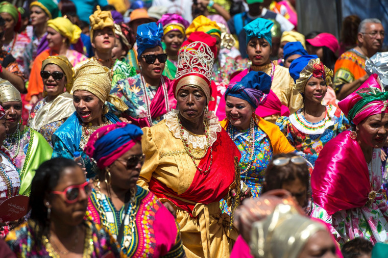 "Image: Women dressed as ""madamas"" dance as they take part in a parade during the carnival in El Callao, Bolivar state, Venezuela on Feb. 26, 2017."