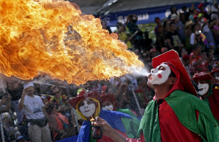 Image: A performer breaths fire during the Great Traditional Parade at the Barranquilla Carnival, in Barranquilla, Colombia, Feb. 26, 2017.