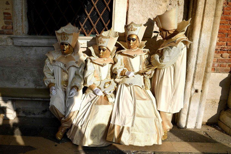 Image: Carnival goers dressed in masks and period costumes on Feb. 19, 2017 in Venice, Italy.