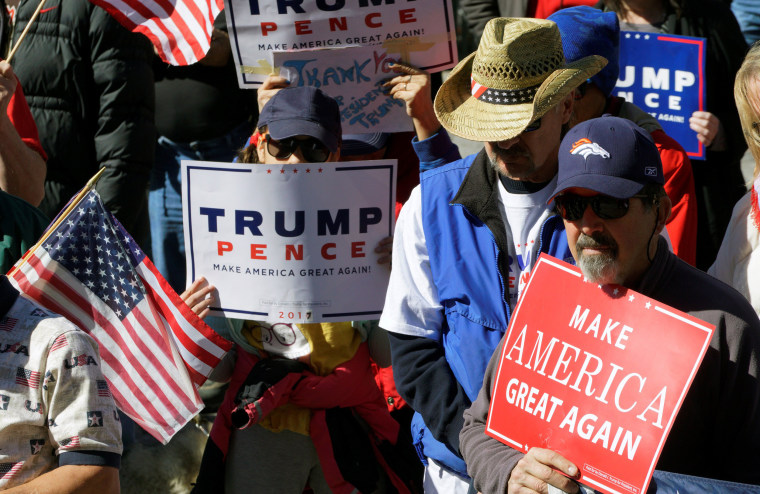"Image: Supporters of U.S. President Donald Trump pray at a ""Spirit of America"" rally in Denver"