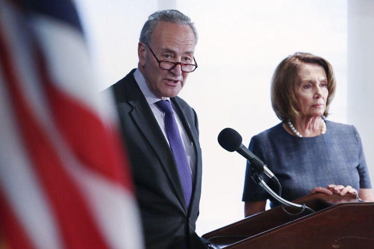 Image: Schumer and Pelosi hold a news conference in prebuttal to Trump's address to Congress