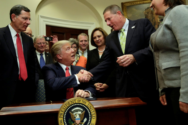 Image: U.S. President Donald Trump greets guests after signing the water executive order at the White House, in Washington