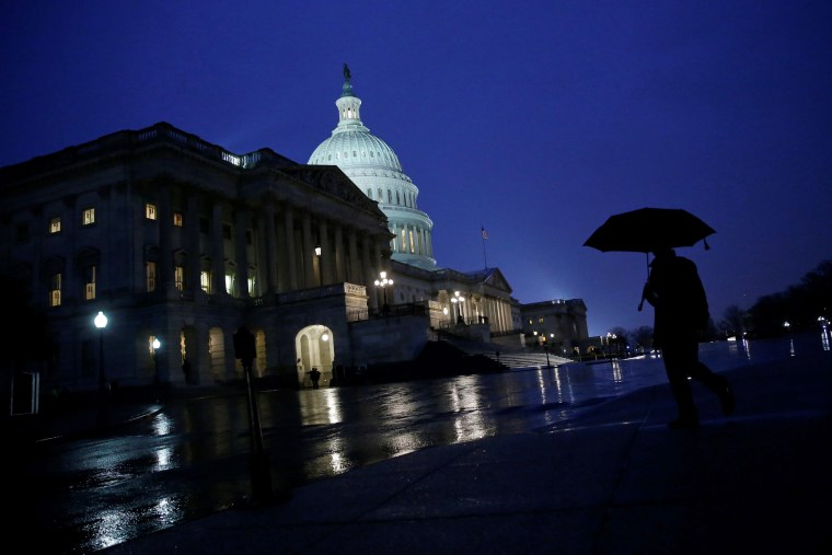 Image: Rain falls outside the U.S. Capitol before Trump addresses a joint session of the U.S. Congress in Washington