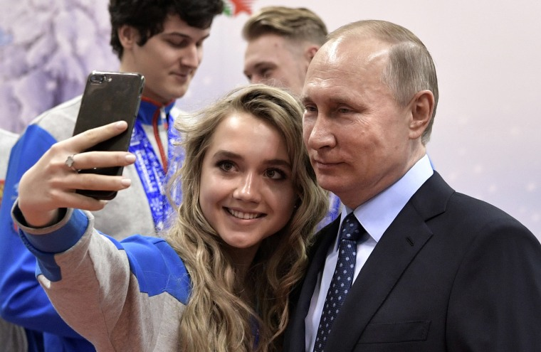 Image: Vladimir Putin poses for a photo