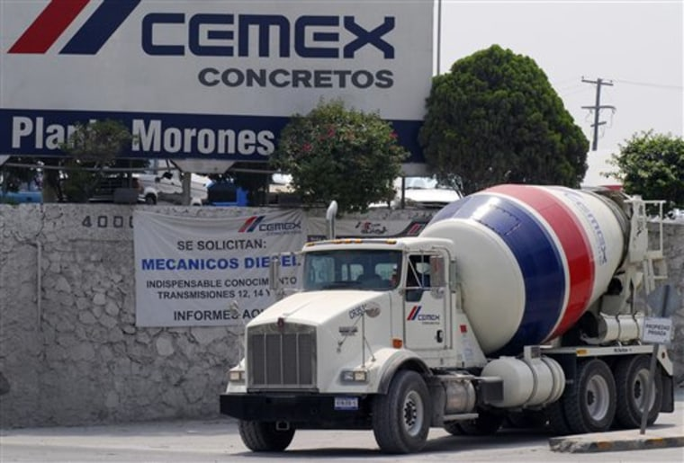 A cement truck leaves the Cemex SA cement distribution center in Monterrey, Mexico, June 7, 2007.