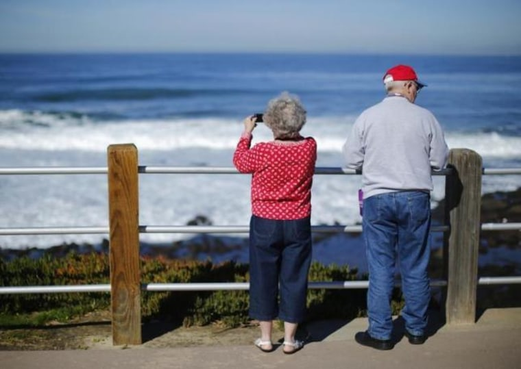 A retired couple take in the ocean during a visit to the beach in La Jolla, California